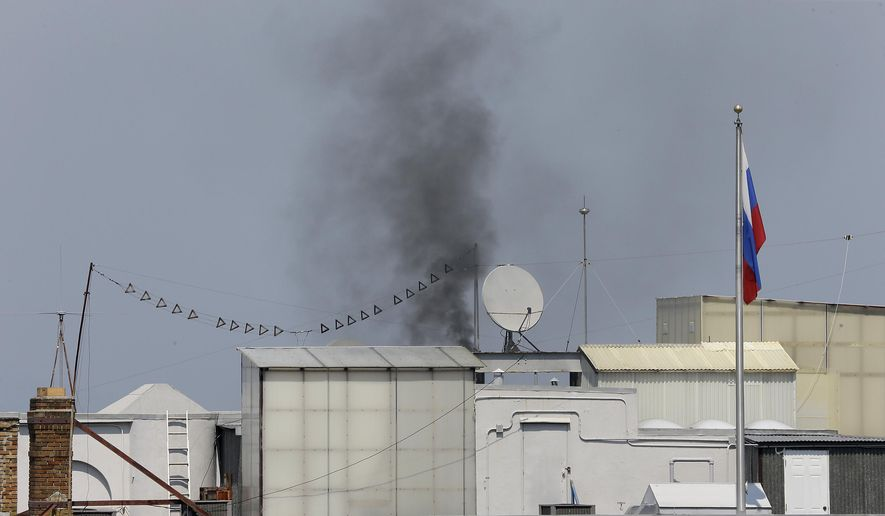 Black smoke comes wafts from the roof of the Consulate-General of Russia Friday, Sept. 1, 2017, in San Francisco. The San Francisco Fire Department says acrid, black smoke seen pouring from a chimney at the Russian consulate in San Francisco was apparently from a fire burning in a fireplace. The smoke was seen billowing from the consulate building a day after the Trump administration ordered its closure. (AP Photo/Eric Risberg)