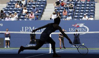 Caroline Garcia, of France, returns a shot from Petra Kvitova, of the Czech Republic, during the third round of the U.S. Open tennis tournament, Friday, Sept. 1, 2017, in New York. (AP Photo/Seth Wenig)