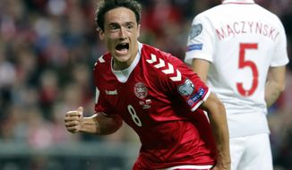 Denmark's Thomas Delaney celebrates scoring, during the World Cup Group E qualifying soccer match between Denmark and Poland at Parken stadium in Copenhagen, Denmark, Friday, Sept. 1, 2017. (Jens Dresling/Ritzau via AP)