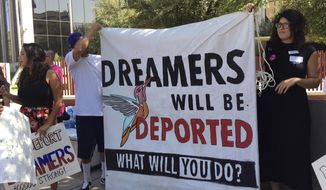 Immigrant rights groups, advocating for DACA, the program that allows youths who were brought to the country illegally as children to legally work and be shielded from deportation, rally in Phoenix, Ariz., Monday, Aug. 28, 2017. President Donald Trump is deciding whether to keep the program as Republican officials from 10 states have threatened to sue to stop the program, giving Trump a Sept. 5 deadline to act. (AP Photo/Astrid Galvan)