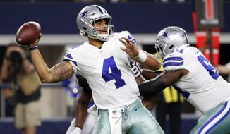 FILE - In this Saturday, Aug. 26, 2017, file photo, Dallas Cowboys' Dak Prescott (4) throws a pass in the first half of a preseason NFL football game against the Oakland Raiders in Arlington, Texas. When Tom Brady, Drew Brees and Aaron Rodgers are ready to move on from the NFL, the quarterback position will still be in good hands. Derek Carr, Marcus Mariota, Jameis Winston, Prescott and Carson Wentz seem on their way to filling big shoes. (AP Photo/Michael Ainsworth, File)