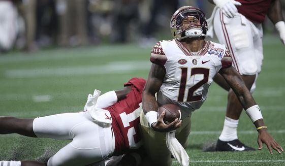 Alabama defensive back Ronnie Harrison (15) hits Florida State quarterback Deondre Francois (12) during the second half of an NCAA football game, Saturday, Sept. 2, 2017, in Atlanta. Alabama won 24-7. (AP Photo/John Bazemore)
