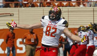 Maryland tight end Michael Wilson celebrates Maryland's first touchdown during the first half of an NCAA college football game against Texas, Saturday, Sept. 2, 2017, in Austin, Texas. (AP Photo/Michael Thomas)