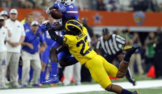 Michigan safety Tyree Kinnel (23) breaks up a pass intended for Florida wide receiver Brandon Powell (4) in the second half of an NCAA college football game, Saturday, Sept. 2, 2017, in Arlington, Texas. (AP Photo/Tony Gutierrez)