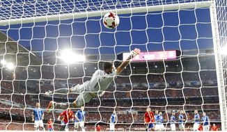 Italy goalkeeper Gianluigi Buffon fails to stop a goal from Spain's Isco to open the score during the World Cup Group G qualifying soccer match between Spain and Italy at the Santiago Bernabeu Stadium in Madrid, Saturday Sept. 2, 2017. (AP Photo/Paul White)