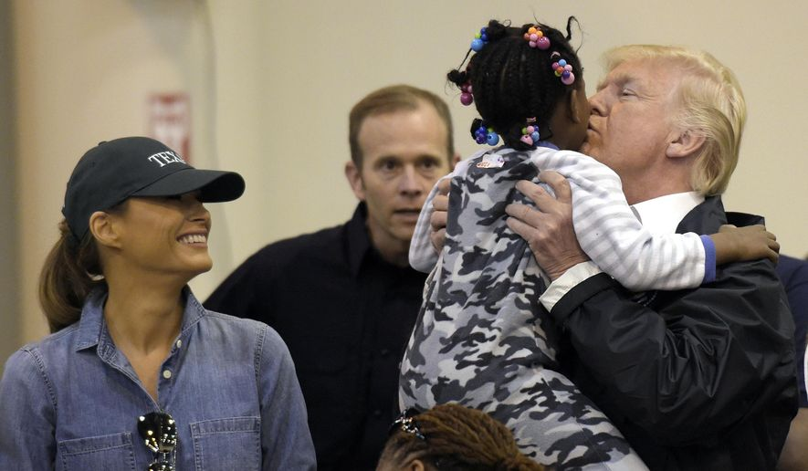 The overwhelming approval of President Trump's responses to Hurricanes Harvey and Irma, which included a deal to quickly pass federal disaster funds tied to the debt limit increase and short-term funding to keep the government open. (Associated Press/File)