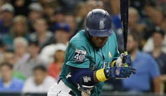 Seattle Mariners' Robinson Cano is hit by a pitch during the third inning of a baseball game against the Oakland Athletics, Friday, Sept. 1, 2017, in Seattle. (AP Photo/Ted S. Warren)