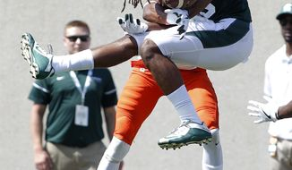 Michigan State's Felton Davis III (18) and Bowling Green's Fred Garth, rear, vie for a pass that would fall incomplete during the second quarter of an NCAA college football game, Saturday, Sept. 2, 2017, in East Lansing, Mich. (AP Photo/Al Goldis)