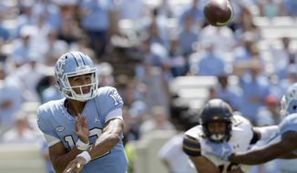 North Carolina quarterback Chazz Surratt (12) passes against California during the second half of an NCAA college football game in Chapel Hill, N.C., Saturday, Sept. 2, 2017. California won 35-30. (AP Photo/Gerry Broome)