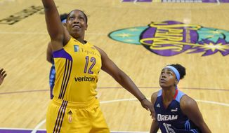 Los Angeles Sparks guard Chelsea Gray, left, shoots as Atlanta Dream guard Tiffany Hayes defends during the first half of a WNBA basketball game, Friday, Sept. 1, 2017, in Los Angeles. (AP Photo/Mark J. Terrill)