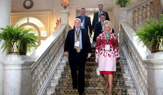 Republican Sen. John McCain, left,  and his wife Cindy, arrive at an economic workshop in Villa d'Este in Cernobbio, Como Lake, Italy, Saturday, Sept. 2, 2017. McCain, accompanied by his wife, Cindy, was one of the VIP guests invited to the annual three-day forum, which gathers experts from the fields of politics, economics, finance and business. The office of the six-term Republican senator said the forum was his first trip during the congressional recess, which he spent undergoing treatment for brain cancer.(Matteo Bazzi/ANSA via AP)