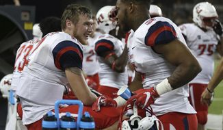 Liberty quarterback Stephen Calvert, left, smiles after his touchdown run with wide receiver DJ Stubbs, right, in the first second half of an NCAA college football gameagainst Baylor, Saturday, Sept. 2, 2017, in Waco, Texas. (Rod Aydelotte/Waco Tribune Herald, via AP)