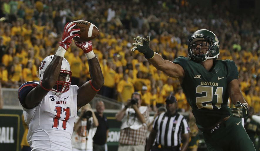 Liberty wide receiver Antonio Gandy-Golden, left, pulls down a touchdown pass over Baylor safety Davion Hall, right, in the first second of an NCAA college football game, Saturday, Sept. 2, 2017, in Waco, Texas. (Rod Aydelotte/Waco Tribune Herald, via AP)  **FILE**