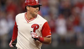 FILE - In this Aug. 26, 2017, file photo, Philadelphia Phillies' Rhys Hoskins runs the bases after hitting a two-run home run in the first inning of a baseball game against the Chicago Cubs, in Philadelphia. Hoskins has been mashing homers at a clip unlike any rookie in baseball history, giving Phillies fans a reason to watch a miserable team headed toward another last-place finish. (AP Photo/Laurence Kesterson, File)