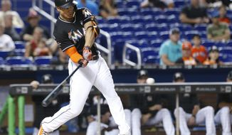 Miami Marlins' Giancarlo Stanton hits a home run during the first inning of a baseball game against the Philadelphia Phillies, Saturday, Sept. 2, 2017, in Miami. (AP Photo/Wilfredo Lee)