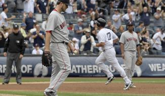 Boston Red Sox pitcher Drew Pomeranz, left, reacts as New York Yankees designated hitter Matt Holliday rounds the bases with a three-run home run, past Red Sox third baseman Rafael Devers, right, during the sixth inning of a baseball game Saturday, Sept.2, 2017, at Yankee Stadium in New York. (AP Photo/Bill Kostroun)