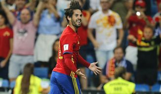 Spain's Isco celebrates after scoring his side's second goal during the World Cup Group G qualifying soccer match between Spain and Italy at the Santiago Bernabeu Stadium in Madrid, Saturday Sept. 2, 2017. (AP Photo/Paul White)