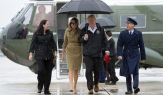 President Donald Trump and first lady Melania Trump walk towards Air Force One at Andrews Air Force Base in Md., Saturday, Sept. 2, 2017.  The President is heading to Houston and Lake Charles, Louisiana to survey Harvey's devastation.  (AP Photo/Susan Walsh)