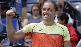 Alexandr Dolgopolov, of Ukraine, reacts after defeating Viktor Troicki, of Serbia, during the third round of the U.S. Open tennis tournament, Saturday, Sept. 2, 2017, in New York. (AP Photo/Peter Morgan)