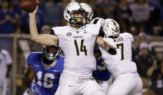 Vanderbilt quarterback Kyle Shurmur (14) passes against Middle Tennessee in the first half of an NCAA college football game Saturday, Sept. 2, 2017, in Murfreesboro, Tenn. (AP Photo/Mark Humphrey)