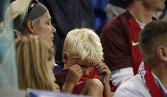 A young fan cries during the final minutes of a World Cup qualifying soccer match as Costa Rica defeats the United States 2-0, Friday, Sept. 1, 2017, in Harrison, N.J. (AP Photo/Julio Cortez)