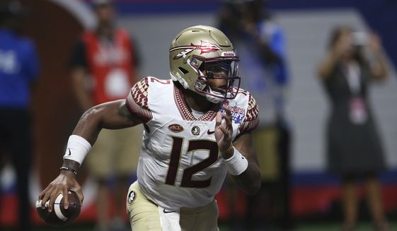 Florida State quarterback Deondre Francois (12) runs against Alabama during the second half of an NCAA football game, Saturday, Sept. 2, 2017, in Atlanta. Alabama won 24-7. (AP Photo/John Bazemore)