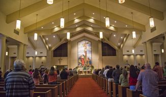 People gather for Mass at Our Lady of Sorrows Catholic Church in Victoria, Texas, Sunday, Sept. 3, 2017. Sunday was declared a day of prayer in Texas by Gov. Greg Abbott and across the nation by President Donald Trump. He and the first lady attended services at St. John's, an Episcopal church in Washington, a day after visiting Harvey evacuees in Houston and Louisiana. (Olivia Vanni/The Victoria Advocate via AP)