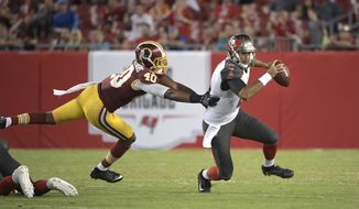 Tampa Bay Buccaneers quarterback Sefo Liufau (8), right, scrambles for yardage past Washington Redskins linebacker Josh Harvey-Clemons (40) during the second half of an NFL preseason football game Thursday, Aug. 31, 2017, in Tampa, Fla. The Redskins won 13-10. (AP Photo/Phelan M. Ebenhack)