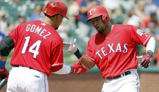 Texas Rangers' Carlos Gomez (14) and Elvis Andrus, right, celebrate a solo home run hit by Andrus in the third inning of a baseball game against the Los Angeles Angels on Sunday, Sept. 3, 2017, in Arlington, Texas. (AP Photo/Tony Gutierrez)