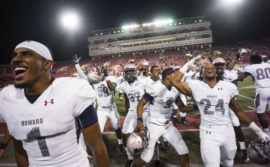 Howard players celebrate after defeating UNLV 43-40 during an NCAA college football game at Sam Boyd Stadium in Las Vegas on Saturday, Sept. 2, 2017. (Chase Stevens/Las Vegas Review-Journal via AP)