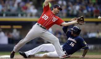 Milwaukee Brewers' Domingo Santana (16) steals second base as Washington Nationals' Daniel Murphy takes a late throw during the sixth inning of a baseball game Sunday, Sept. 3, 2017, in Milwaukee. (AP Photo/Jeffrey Phelps)