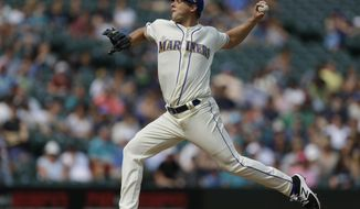 Seattle Mariners starting pitcher Andrew Albers throws against the Oakland Athletics in the fourth inning of a baseball game, Sunday, Sept. 3, 2017, in Seattle. (AP Photo/Ted S. Warren)