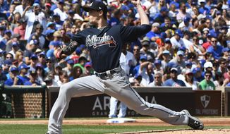 Atlanta Braves starting pitcher Max Fried (61) delivers during the first inning of a baseball game against the Chicago Cubs on Sunday, Sept. 3, 2017, in Chicago. (AP Photo/Matt Marton)
