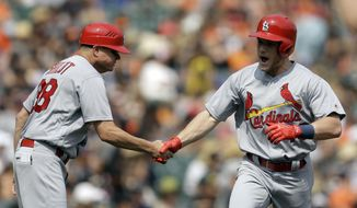 St. Louis Cardinals' Harrison Bader, right, celebrates with third base coach Mike Shildt after hitting a home run off San Francisco Giants' Madison Bumgarner in the sixth inning of a baseball game Sunday, Sept. 3, 2017, in San Francisco. (AP Photo/Ben Margot)