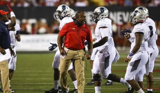 Howard coach Mike London shouts to his team during an NCAA college football game against UNLV at Sam Boyd Stadium in Las Vegas on Saturday, Sept. 2, 2017. (Chase Stevens/Las Vegas Review-Journal via AP)