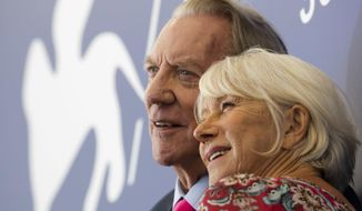 """Actors Donald Sutherland, left, and Helen Mirren pose during a photo call for the film """"The Leisure Seeker"""" at the 74th Venice Film Festival in Venice, Italy, Sunday, Sept. 3, 2017. (AP Photo/Domenico Stinellis)"""
