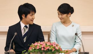 Japan's Princess Mako, right, the elder daughter of Prince Akishino and Princess Kiko, and her fiance Kei Komuro, look at each other during a press conference at Akasaka East Residence in Tokyo, Sunday, Sept. 3, 2017. Japanese Emperor Akihito's oldest grandchild, Princess Mako, says she is getting married to her university classmate who won her heart with bright smiles and sincerity.(AP Photo/Shizuo Kambayashi, Pool)