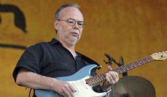 In this Sunday, May 6, 2007, file photo, Walter Becker, of Steely Dan, performs during the 2007 Jazz and Heritage Festival in New Orleans. Becker, the guitarist, bassist and co-founder of the rock group Steely Dan, has died. He was 67. His official website announced his death Sunday, Sept. 3, 2017, with no further details. (AP Photo/Dave Martin, File)
