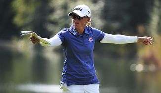 Stacy Lewis check her distance on the fourth hole during the final round of the Cambia Portland Classic golf tournament in Portland, Ore., Sunday Sept. 3, 2017. (AP Photo/Steve Dykes)