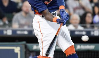 Houston Astros' Cameron Maybin hits a three-run home run off New York Mets starting pitcher Chris Flexen during the third inning of a baseball game, Sunday, Sept. 3, 2017, in Houston. (AP Photo/Eric Christian Smith)