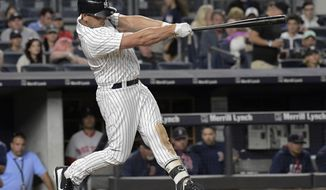 New York Yankees' Matt Holliday hits a home run during the fourth inning of a baseball game against the Boston Red Sox, Sunday, Sept. 3, 2017, at Yankee Stadium in New York. (AP Photo/Bill Kostroun)