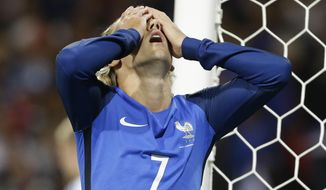 France's Antoine Griezmann reacts after missing a chance to score during the World Cup Group A qualifying soccer match between France and Luxembourg at the Stadium municipal in Toulouse, France, Sunday, Sept. 3, 2017. (AP Photo/Claude Paris)
