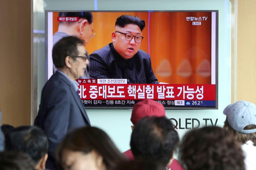 """People watch a TV news program showing North Korean leader Kim Jong Un at the Seoul Railway Station in Seoul, Sunday, Sept. 3, 2017. North Korea said it set off a hydrogen bomb Sunday in its sixth nuclear test, which judging by the earthquake it set off appeared to be its most powerful explosion yet. The signs read """"North Korea, important announcement."""" (AP Photo/Ahn Young-joon)"""