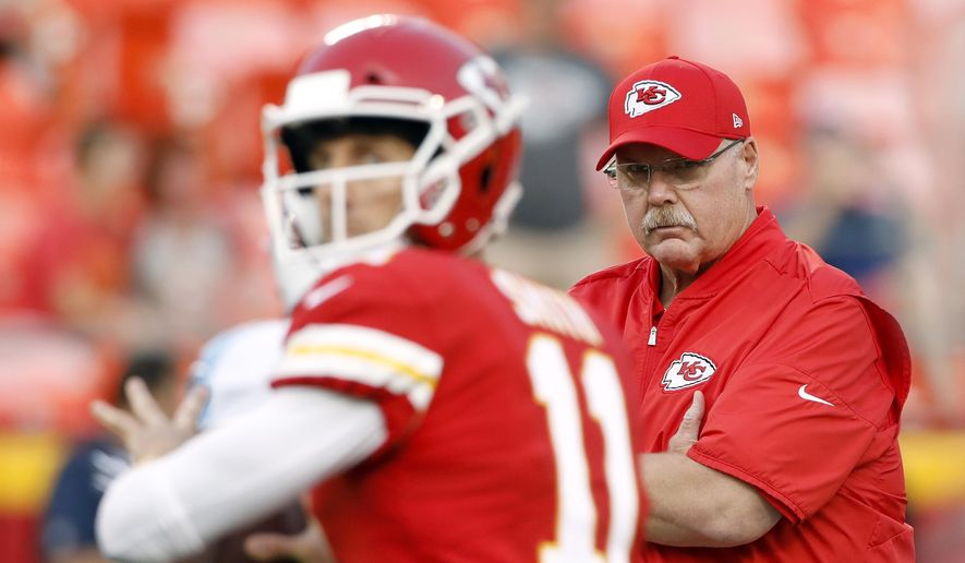 Kansas City Chiefs head coach Andy Reid, right, watches quarterback Alex Smith (11) before an NFL preseason football game against the Tennessee Titans in Kansas City, Mo., Thursday, Aug. 31, 2017. (AP Photo/Colin E. Braley)