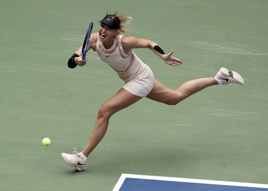 Maria Sharapova, of Russia, returns a shot from Anastasija Sevastova, of Latvia, during the fourth round of the U.S. Open tennis tournament, Sunday, Sept. 3, 2017, in New York. (AP Photo/Frank Franklin II)