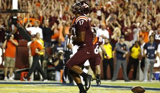 Virginia Tech quarterback Josh Jackson celebrates after scoring a touchdown in the first half of an NCAA college football game against West Virginia in Landover, Md., Sunday, Sept. 3, 2017. (AP Photo/Patrick Semansky)