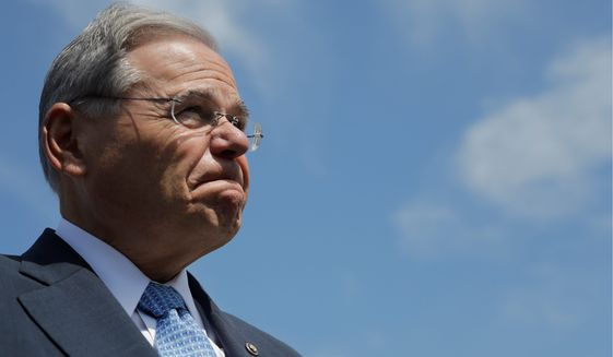 Sen. Robert Menendez, New Jersey Democrat, will be facing federal charges in a courtroom this month instead of casting votes on Capitol Hill. (Associated press)