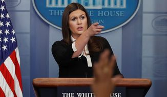 Sarah Huckabee Sanders, the first working mother to be the chief White House spokesperson, said her faith helps keep her grounded in the adversarial position as President Trump's chief defender against a mostly liberal press corps. (Associated Press/File)