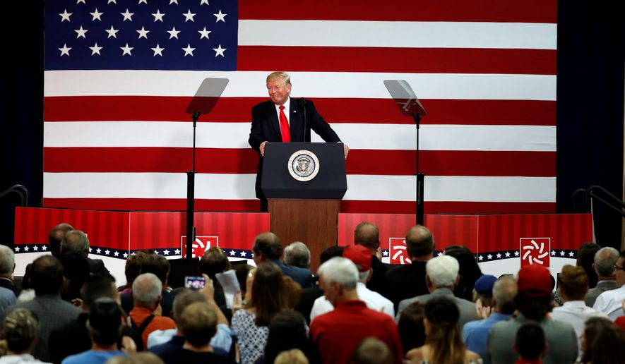 President Donald Trump pauses while delivering remarks on tax reform at the Loren Cook Company on Aug. 30 in Springfield, Missouri. (AP Photo/Jeff Roberson)