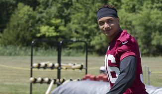 Washington Redskins' safety Su'a Cravens (36) walks to the field during the first day of the NFL football teams minicamp at Redskins Park in Ashburn, Va., Tuesday, June 14, 2016. (AP Photo/Manuel Balce Ceneta)